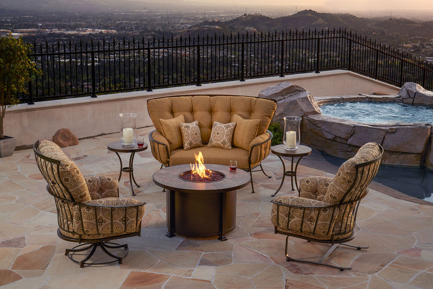 Monterra lounge collection with fire pit on tile patio overlooking the city