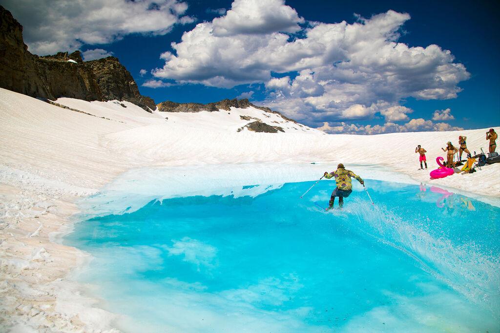 Skiers enjoying spring conditions pond skimming