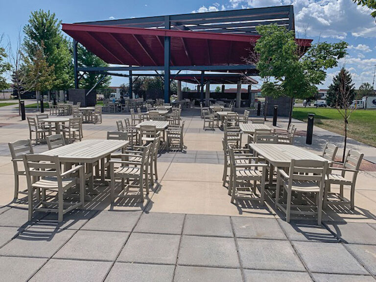 commercial outdoor dining furniture in a corporate setting