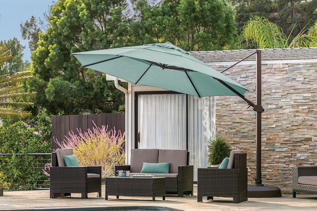 Cantilever umbrella covering patio furniture