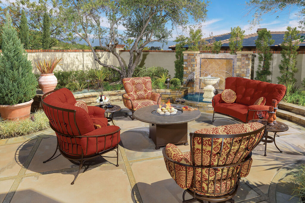 Monterra lounge collection with fire pit in sunny backyard