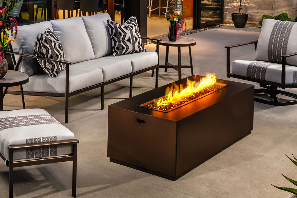 Rectangular fire pit with lounge furniture