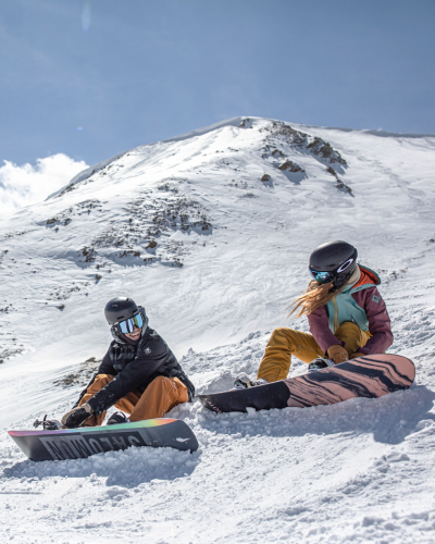 snowboarders chillin before they drop in