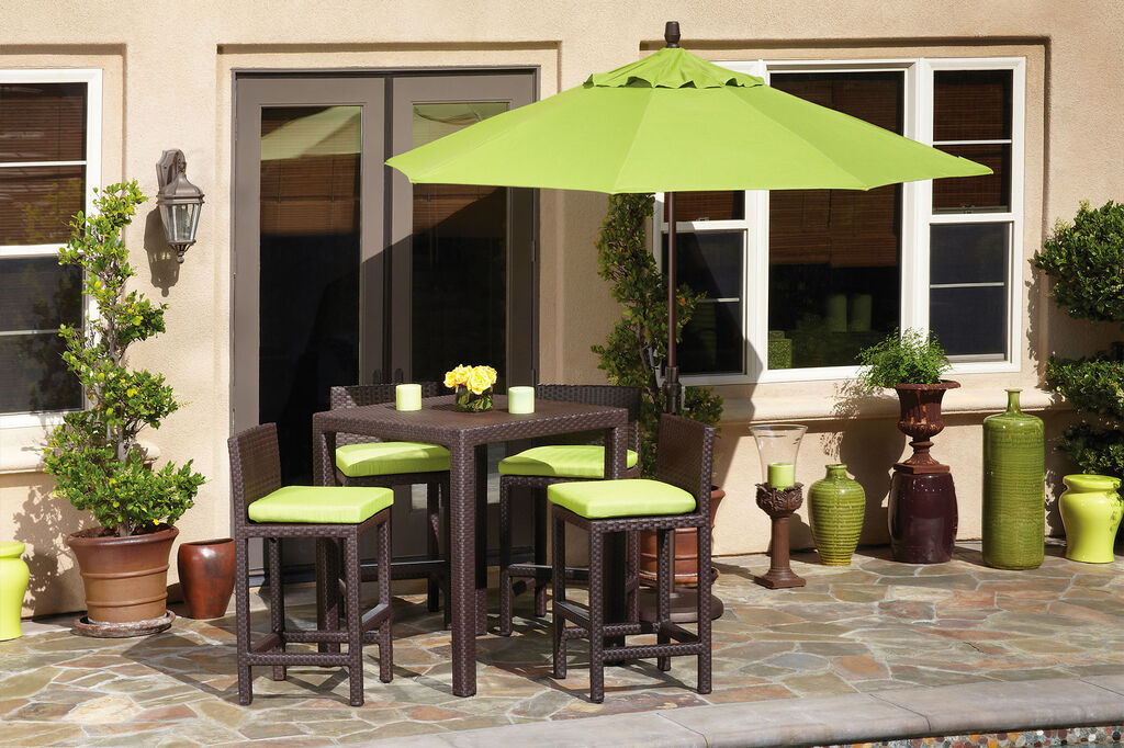 Market umbrella coving a set of dining furniture