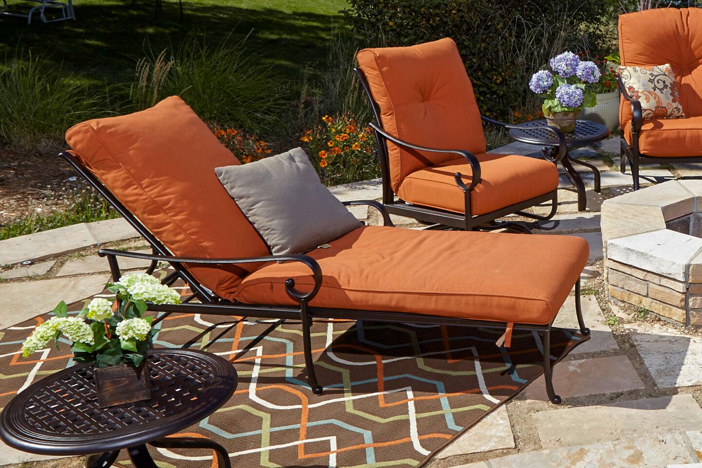Hanamint Santa Barbara chaise lounger with orange cushions
