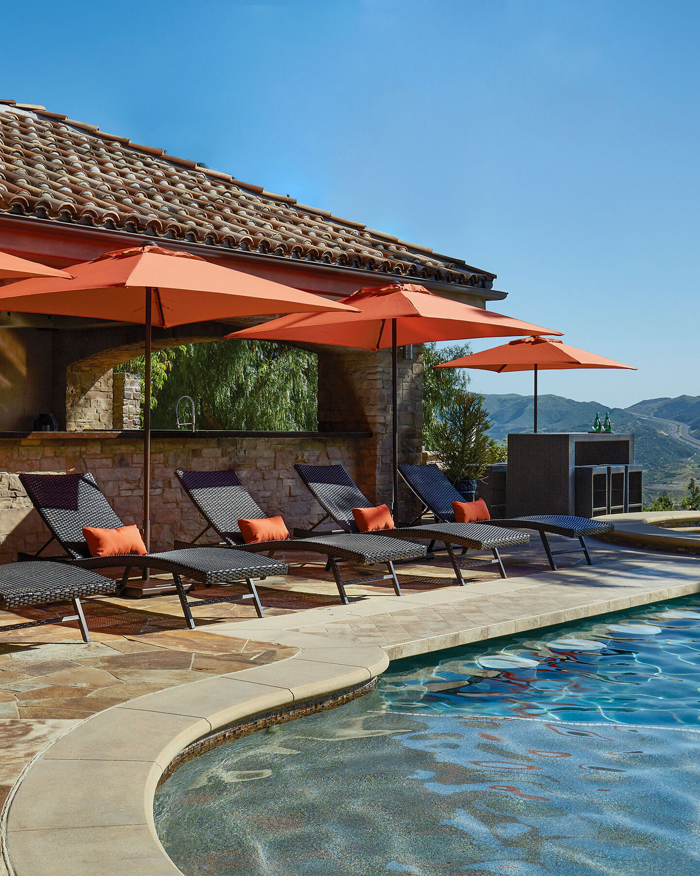 commercial patio furniture series of chaise lounges with umbrellas poolside