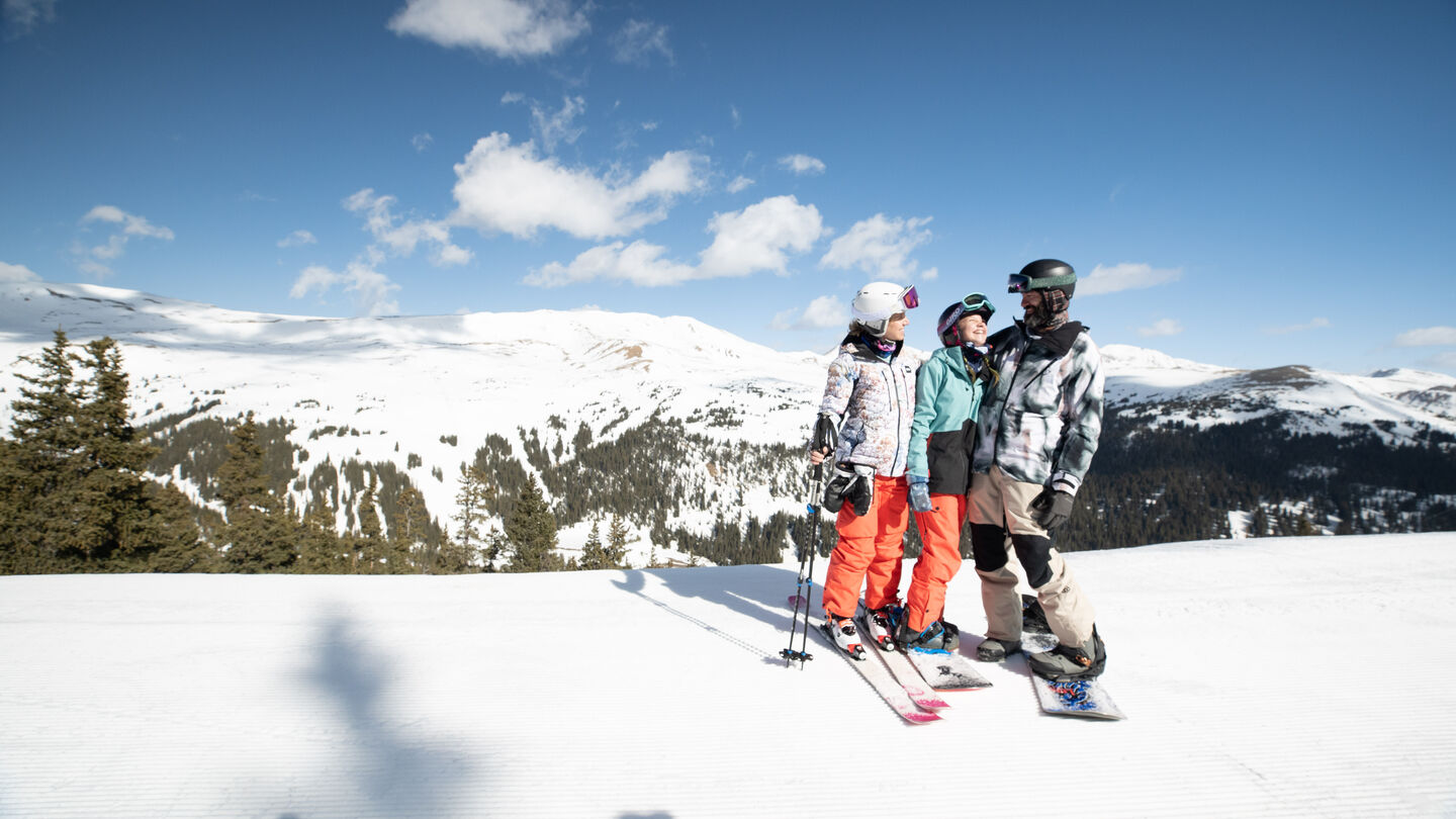 Family Laughing on a ski hill