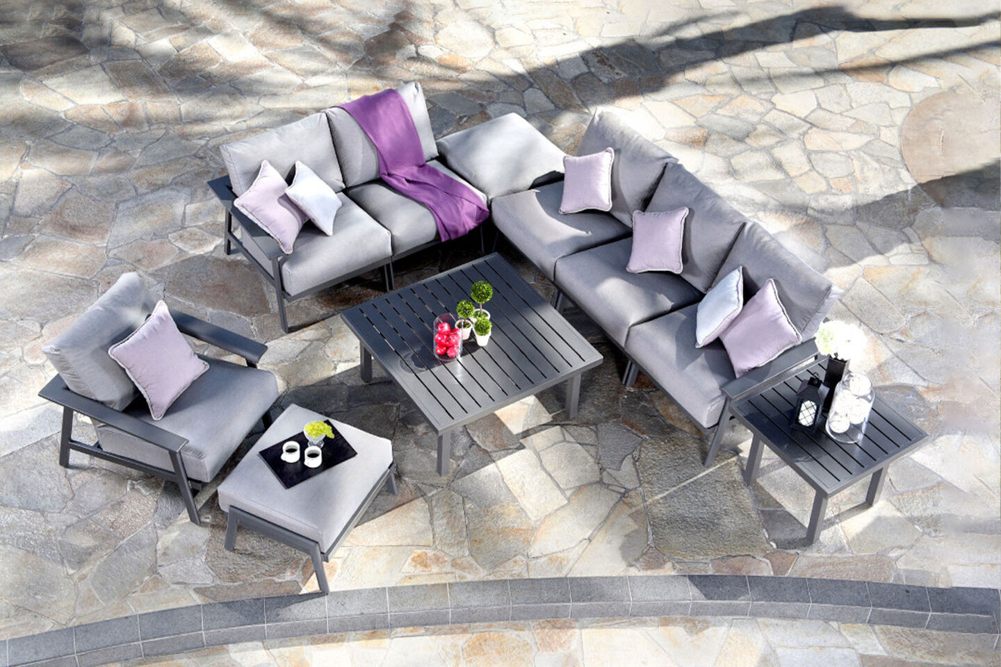 Dakoda by Mallin lounge furniture arrangement with tables and outdoor cushions