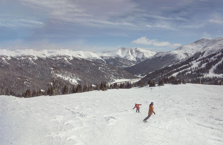 skiers walking across the hill