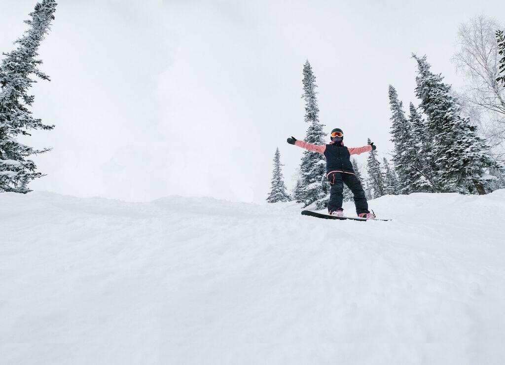 snowboarder celebrating in deep powder