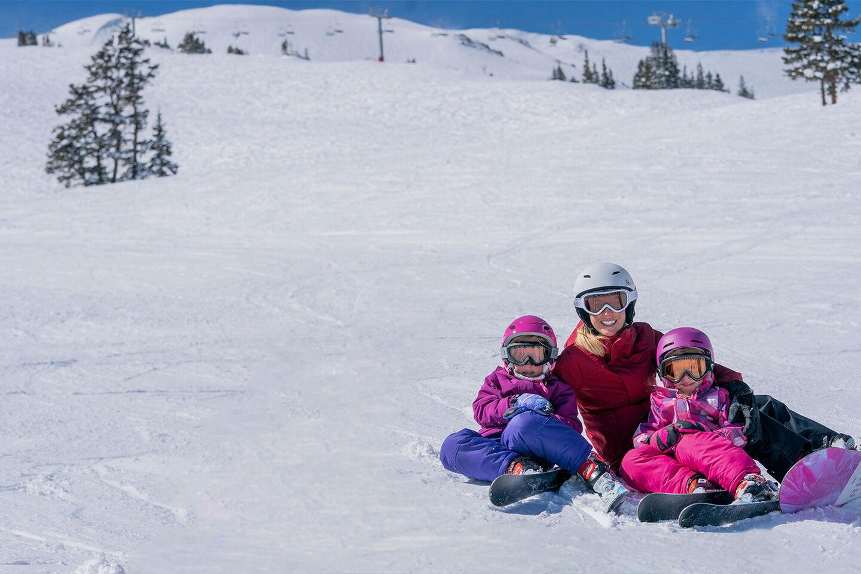 family smiling sitting on mountain