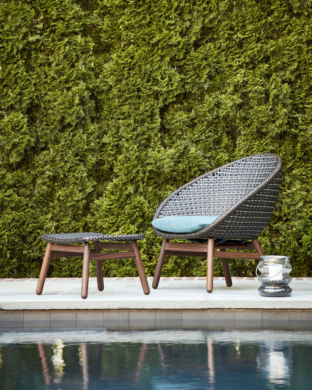 Nest by Jensen Outdoor poolside patio chair and ottoman with ipe wood base and Viro Fiber woven tops