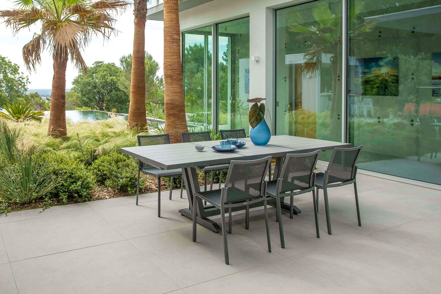 Amaka by Les Jardins dining furniture collection on concrete patio