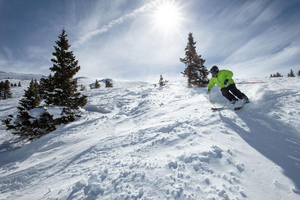 Skier making turns on open run