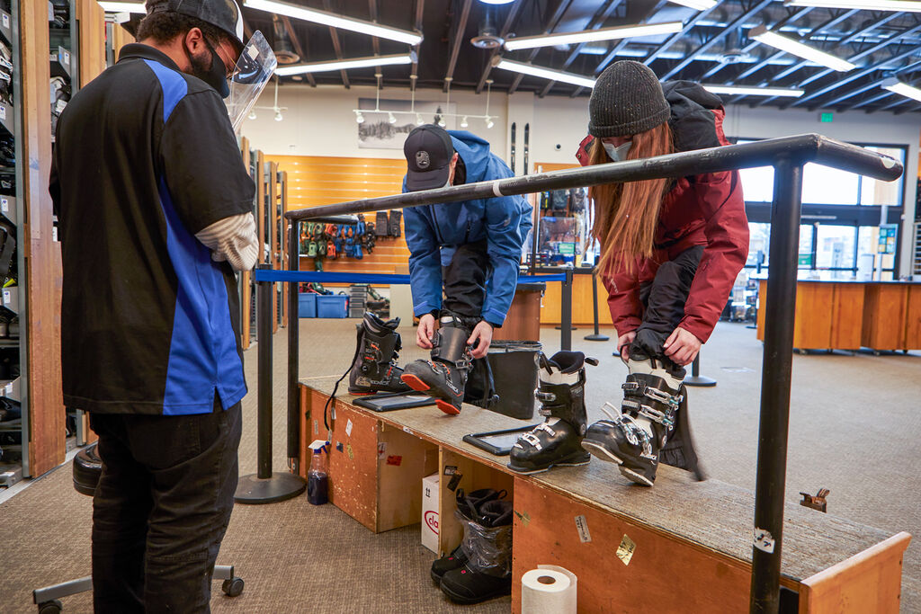 Couple picking up ski rentals at Christy Sports