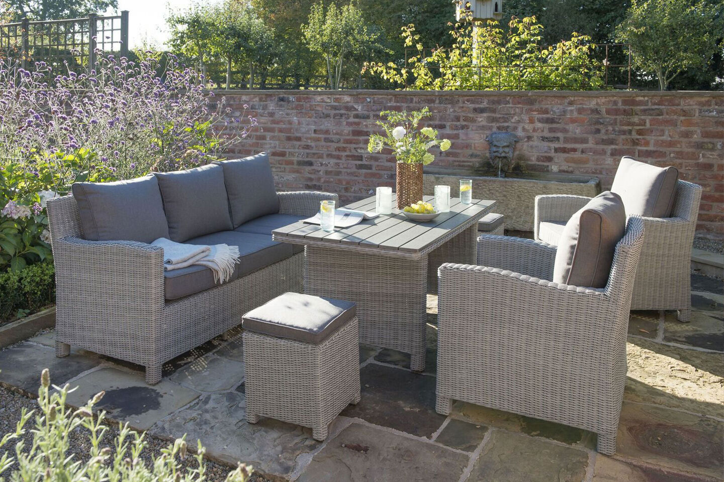 Palma & Cupido by Kettler gray woven lounge furniture on slate patio