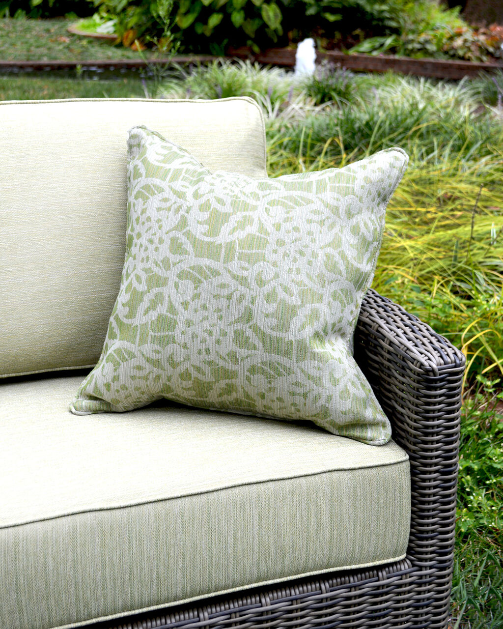 Durable outdoor cushions & pillows with Sunbrella fabric on woven loveseat