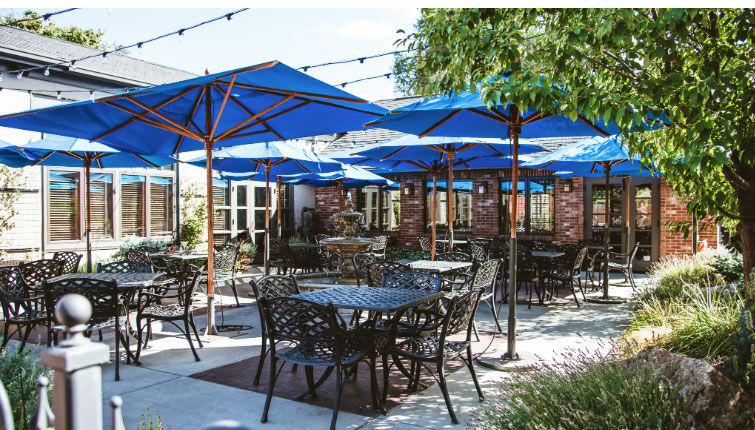 restaurant with commercial dining patio furniture and umbrellas