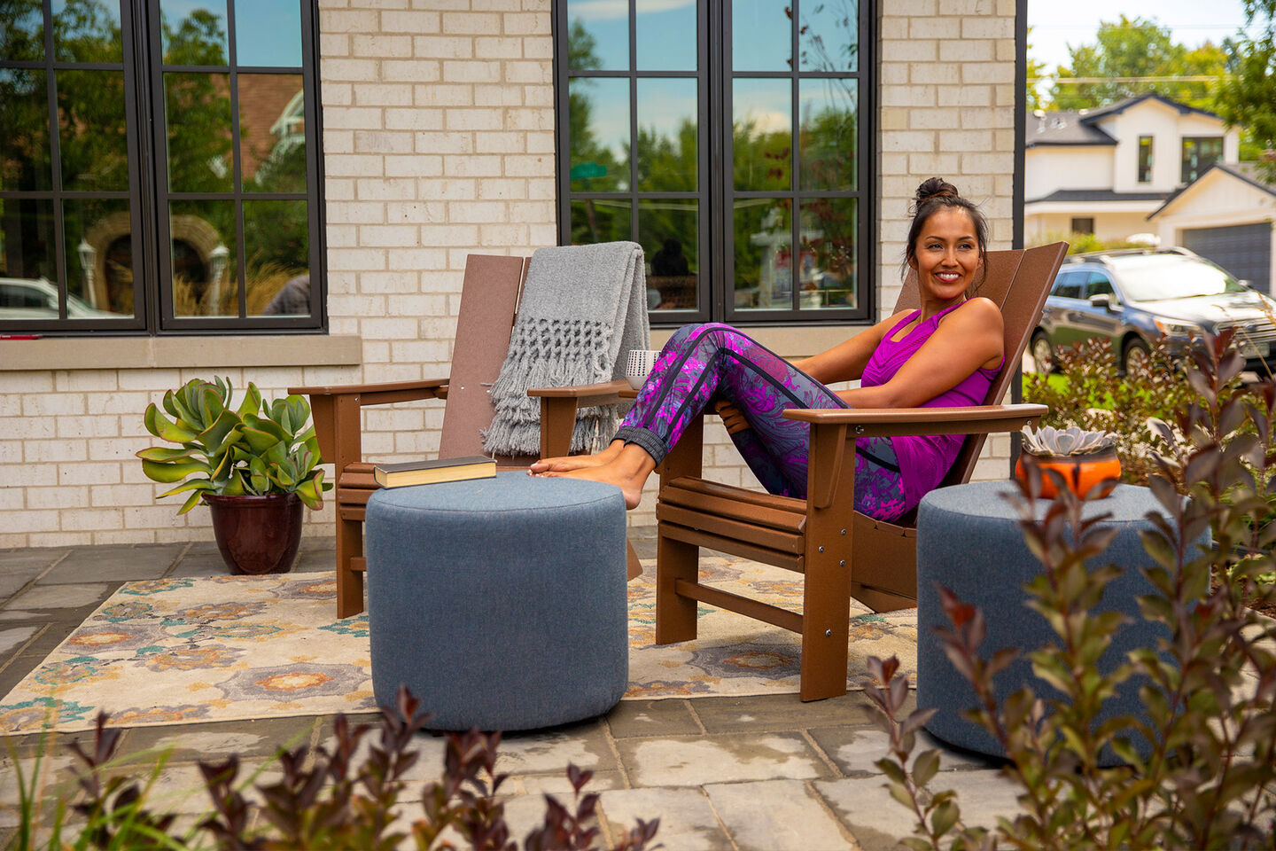 Woman on Patio enjoying outdoor furniture from Christy Sports