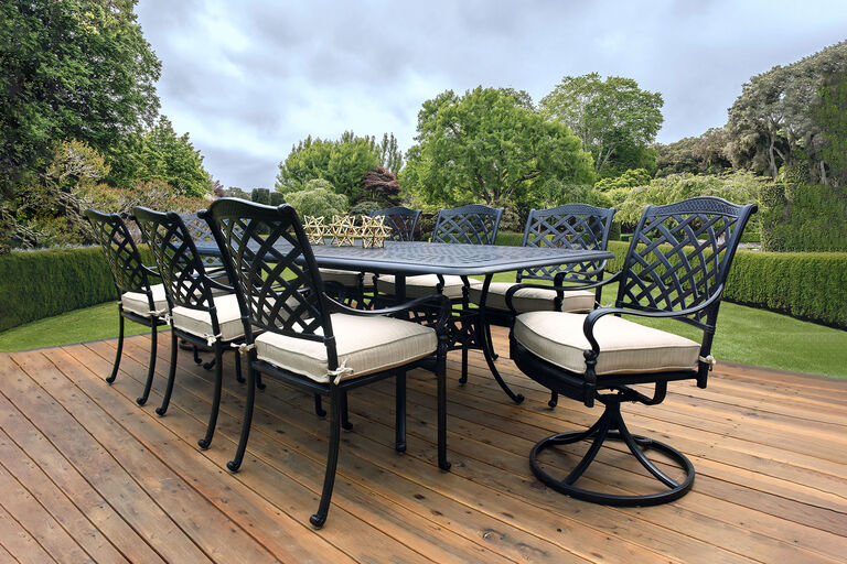 Berkshire by Hanamint cast aluminum dining furniture collection on wooden deck