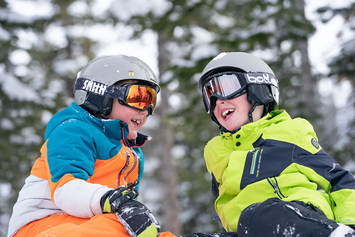 boys smiling and having fun a day at the mountain