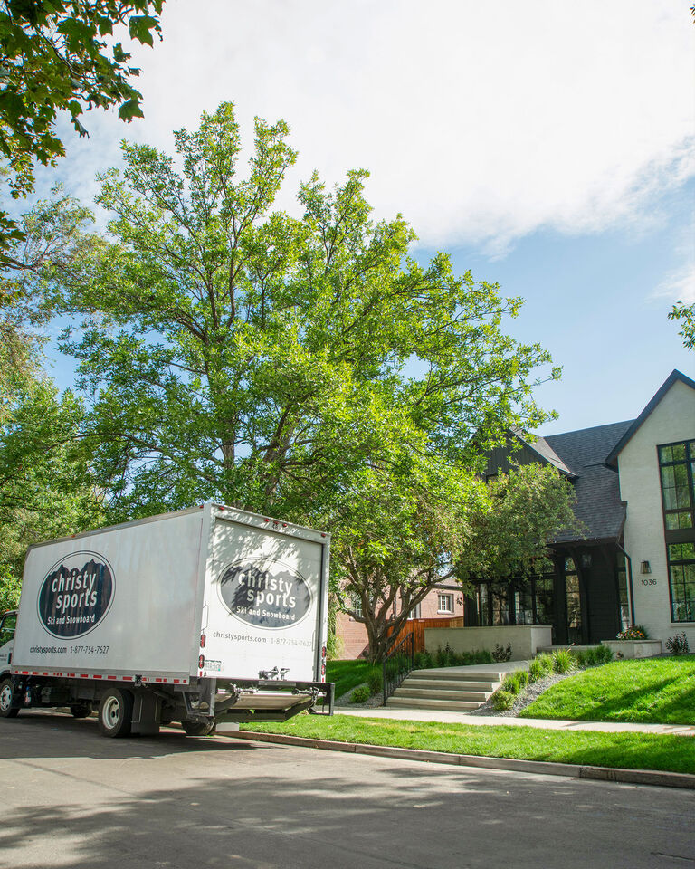Christy Sports truck delivering outdoor furniture to residential property