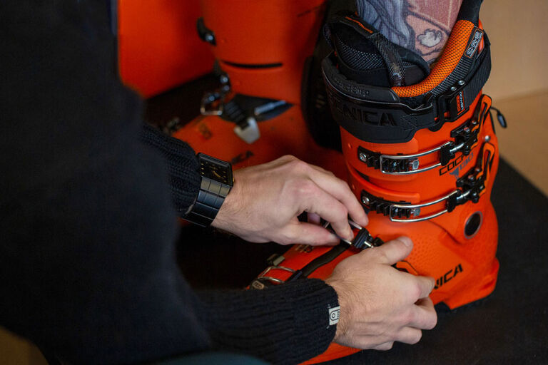 Close up of ski boot being fit