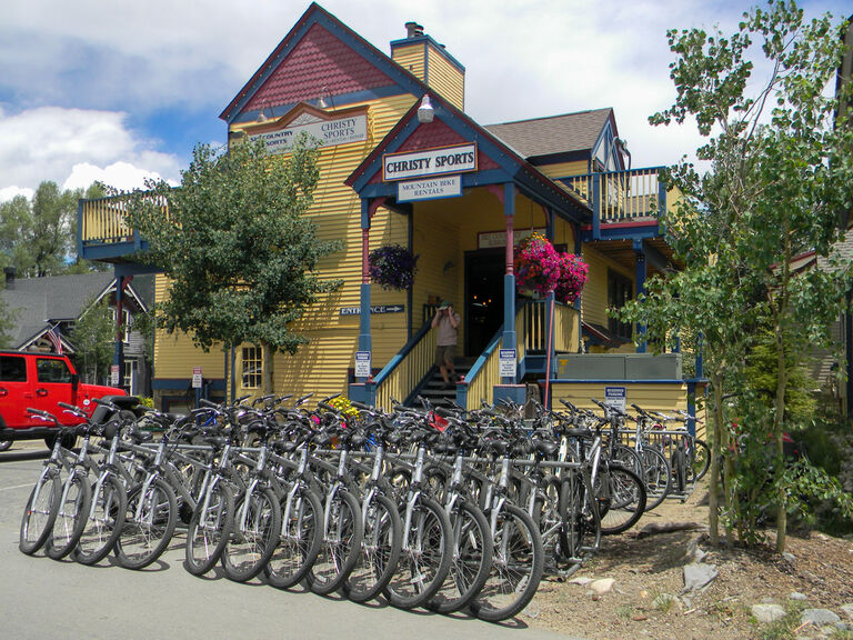 Christy Sports - Breckenridge Gondola Storefront in the summer with bikes for rent out front