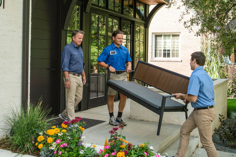 Christy Sports employees delivering outdoor furniture