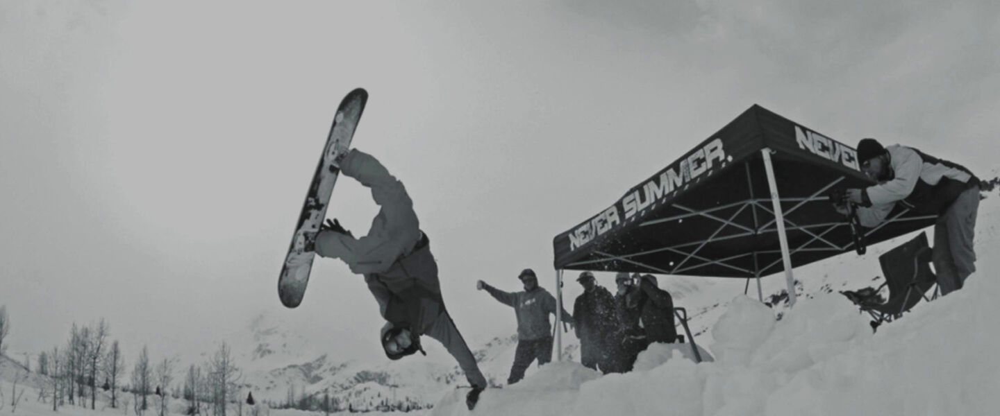 Never Summer rider doing a hand plant