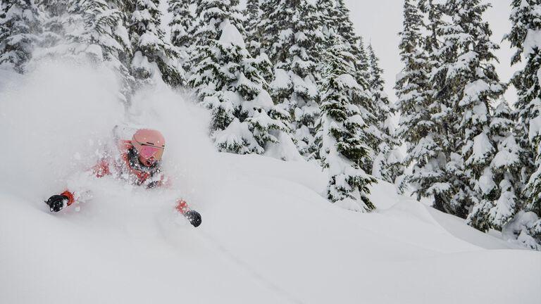 Woman skiing in super deep powder